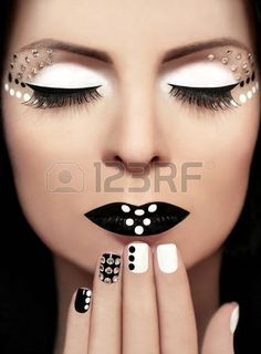 Black and white makeup with rhinestones on a woman s face