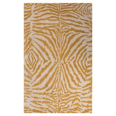 Lend a touch of textured appeal to your living room or master suite with this hand-tufted wool rug, showcasing an animal print motif for exotic appeal.