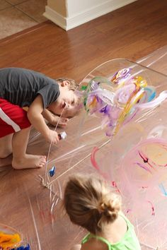 Toddler Big Art: Painting a Rainbow- a Reggio-inspired exploration at Twodaloo...Paint a rainbow then literally crawl inside. Amazing big art project that I can't wait to try.