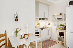 This studio apartment's mini kitchen is perfect.