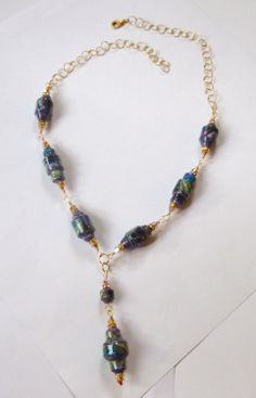 Paper bead necklace with Swarovski crystals, and gold tone chain.