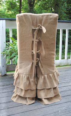 Ruffled linen slipcover with corseted back