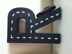 Paint and cardboard initial, for boys muscle car room.