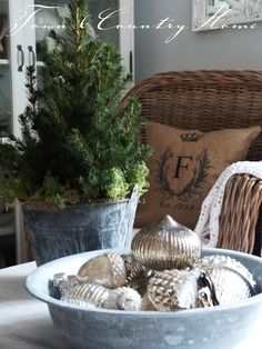 Galvanized bucket w ornaments...add greenery