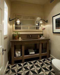 Farmhouse bathroom with shiplap walls, vintage industrial lighting and geometric…