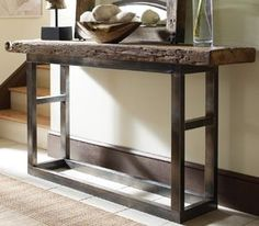 Make something like this but use flat, black spray paint for legs instead of Iron. 'Emeric Iron Leg Console Table'--Very inspiring!