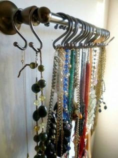 neat way to display & organize long necklaces