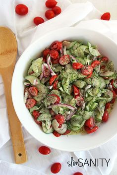 This healthy cucumber salad with dill dressing is the perfect summer side dish, made with a Greek yogurt-based dressing! | slimsanity.com