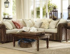 like: sea life cushions, coral rug, faux coral on the coffee table  love the look of the sea grass couch but not sure if the arms would be comfortable, not sure how it would wear, but so pretty