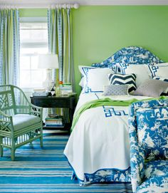 To add weight to this bright green guest room, the designer covered the headboard in a deep blue chinoiserie toile .