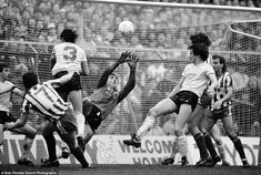 Neville Southall saves a shot from Brian Marwood of Sheffield Wednesday in 1985