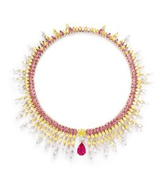 Piaget Sunlight Journey Necklace. Necklace in 18k red gold, pink gold, yellow gold and platinum set with 1 pear-shaped red spinel from Tanzania (approx. 10.09 cts), 1 cushion-cut yellow diamond (FVY-VS2, approx. 6.63 cts), 1 brilliant-cut diamond (F-VVS2, approx. 0.80 cts), red spinels, yellow diamonds and diamonds. Transformable piece.