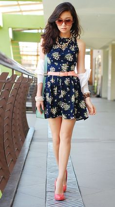 Midnight blue dress, pink belt, pink high heeled shoes, sunglasses and some accessories |
