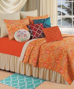 Orange Paisley Quilt looks really pretty with that touch of teal/turquoise