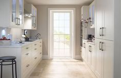 Create A View   A good way to make a galley kitchen seem larger is to put a view at one end - whether a window or door or, failing that, a large picture. Doing so will help visually lengthen the room.