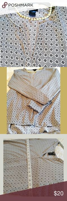 """Ann Taylor Blouse Split neck blouse with small print in excellent condition.  3/4 sleeves. Slight hi low cut, approx 27"""" long in the back, bust approx 38. EUC.Perfect work neutral. Machine wash cold, line dry. Thank you for shopping with me! Ann Taylor Tops Blouses"""