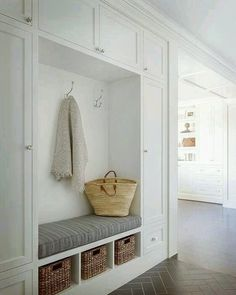 Ideas about Home Design for Beautiful white and gray mudroom with gray herringbone tile floors boasts built in white shaker cabinets and closed lockers with round silver pulls framing a mudroom. Mudroom, Storage Design, Home, Narrow Hallway, Herringbone Floor, White Shaker Cabinets, Entryway Storage, Mud Room Storage, Herringbone Tile Floors