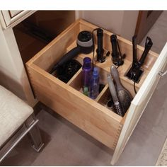 I love this idea of having sectioned storage for each item within the same cabinet!