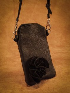 Floral Cellphone Purse. This style comes in red, black, turquoise, brown, saddle tan, pink, and cream. #leather #Canada #handmade #Rockwood #Ontario #like #daily #fashion #hidesinhand Deerskin, Daily Fashion, Red Black, Canada, Turquoise, Handbags, Purses, Cream