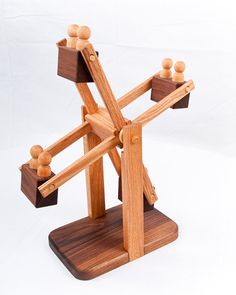 The cutest wooden ferris wheel - made of hardwoods and finished with child-safe beeswax.  Wood toys, wooden toys, organic toys, montessori, waldorf, developmental toys