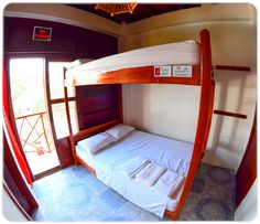 Medium size shared room with two bunk beds that offer flexible sleep arrangements. A private balcony offers beach views & invites fresh sea breezes!