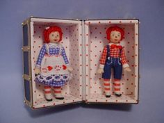 Suitcase  could be made from  a mini  Altoids tin.  Dolls from Fimo clay, the polka dots could be applied with a toothpick dipped in paint. Maybe a doll on one side & a drawer & clothes hanging from the other side, like an old steamer trunk.