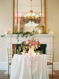 Romantic wedding reception, sweetheart table, pink floral centerpieces, candles, indoor reception, fireplace, see more of this dreamy wedding on borrowdandblue.com // Alicia Ann Photographers