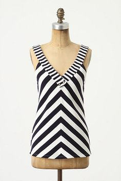 Verbatim Tank #anthropologie.  Great in picture but hated the fit on me. Try this one on first.