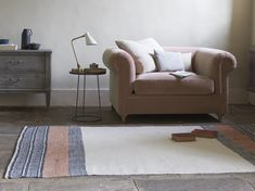 We've used this rug in loads of photo-shoots because it goes with pretty much everything. The dusty pink works a treat with laidback neutrals. Pleated Curtains, Curtains With Blinds, Curtain Accessories, Comfy Sofa, Guest Bed, Leather Sofa, Floor Rugs, Rugs On Carpet, Carpets