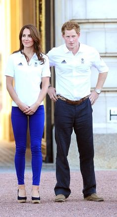 Catherine, Duchess of Cambridge and Prince Harry wait for Wai-Ming to hand over the London 2012 Olympic Torch to John Hulse during a visit to Buckingham Palace, on Day 69 of the London 2012 Olympic Torch Relay on July 26, 2012 in London, England. The Olympic flame is making its way through the capital on the penultimate day of its journey around the UK before arriving in the Olympic Stadium on Friday evening for the Olympic games' Opening Ceremony.