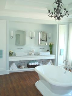Elegant White Bathroom with Freestanding Tub and Dual Vanity