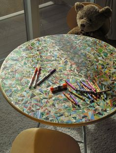 DIY mosaic children's storybook table - great way to create something fun for the kids & re-cycle old books :)