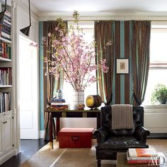 Striped fabric lines the library walls | archdigest.com