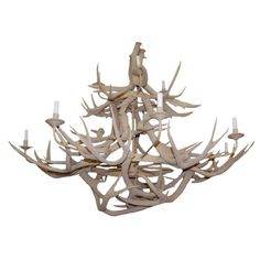 2 Tier Antler Horn Chandelier  American  Circa: 1960  Chandelier composed of clusters of real antler horns. Some are pegged together and others are attached to the iron rings. Chandelier is in 2 tiers (8+4). Painted off white.  Maybe?