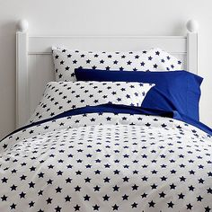 These crisp white kids sheets are covered with patriotic stars in red or blue. Made from soft, 100% cotton percale. Available exclusively at Company Kids.