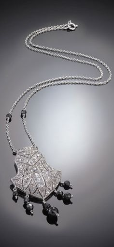 An Art Deco platinum, diamond and onyx pendant, French, circa 1930. #ArtDeco