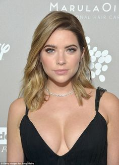 Not so subtle: The dress' plunging neckline ensured the Pretty Little Liars star flashed p...