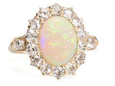 1.5 carat white opal cabochon and diamond ring, circa 1920