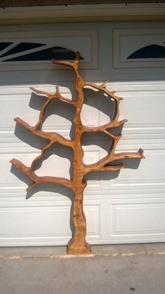 tree shaped bookshelf. Joan Hagadone don't you think Jerry could make this. They sell for $300!:)