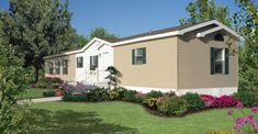 Exterior gardening ideas for a mobile home. Paint shutters green. Plant shrubbery.