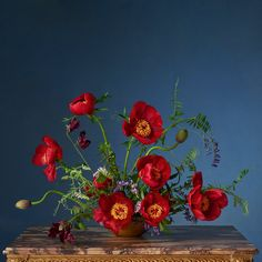 Ariel Dearie Flowers for LOEWE Photo by Steven Meisel. Set Design by Mary Howard. Creative Direction by Jonathan Anderson.   Red Peonies, Poppies, Sweetpeas