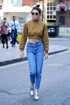 While in London, Kendall Jenner steps out in high-waisted jeans and a cropped sweatshirt.    - HarpersBAZAAR.com