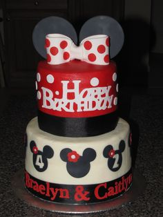 Minnie Mouse cake - Minnie Mouse Cake - iced in buttercream with fondant decorations and ribbon around each layer - i used my cricut cake to cut the letter and minnies .