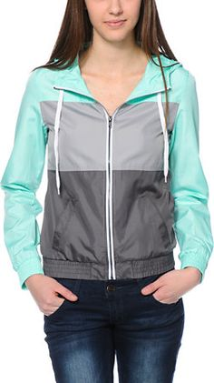 Step out in style rain or shine in the Mint and Grey Colorblock windbreaker jacket from Zine. This windbreaker jacket is super lightweight and unlined making it perfect for layering ,while the polyester construction with drawstring hood will help protect Black Rain Jacket, North Face Rain Jacket, Rain Jacket Women, Mens Raincoat, Green Raincoat, Womens Windbreaker, Windbreaker Jacket, Cute Jackets, Athletic Wear