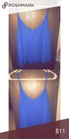 Cris cross chiffon tank Worn once beautiful Royal blue chiffon tank!! has some type of spots on front that probably wash out size medium Charlotte Russe Tops Camisoles