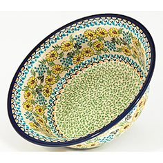 @Overstock - Add style and color to your dining table with this floral pottery bowl. The stoneware bowl is handcrafted to evenly heat food and hand-painted to provide uniqueness. This dishwasher safe bowl is perfect for serving your guest and adding to your decor.http://www.overstock.com/Worldstock-Fair-Trade/Polish-Stoneware-Pottery-Flared-top-Bowl-Poland/6565918/product.html?CID=214117 $109.99