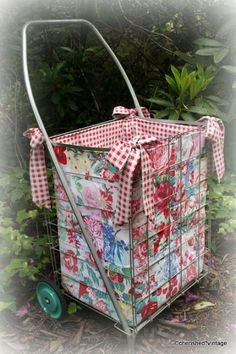 Vintage shopping cart with an extremely cute handmade liner:) I have a cart with a liner I purchased. They are great at flea and farmers markets because nothing falls out of the cart.