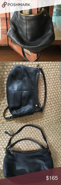J.Crew Pebbled Leather Purse Gorgeous, high quality pebbled leather hobo purse from J. Crew. Black with brass hardware.   Excellent condition, the leather is so soft and the bag looks way more expensive than it was. Slight wear on one corner, some ink stains on fabric lining interior but no serious defects whatsoever. Can be worn on the shoulder or crossbody with the detachable longer strap. A ton of pockets makes this an excellent everyday purse or travel bag!   Also available in soft…