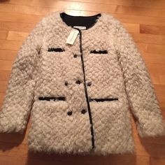 NWT White Hippie Story Jacket NWT Hippie Story Size Small Jacket. Not sure of the Faux Fur. Gorgeous & fluffy! Lined with cloth inside. Please ask all questions prior to buying. I bundle Jackets & Coats