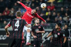 Hugo Almeida of Hannover jumps for a header with Carlos Zambrano of Frankfurt (R) during the Bundesliga match between Eintracht Frankfurt and Hannover 96 at Commerzbank-Arena on March 19, 2016 in Frankfurt am Main, Germany.